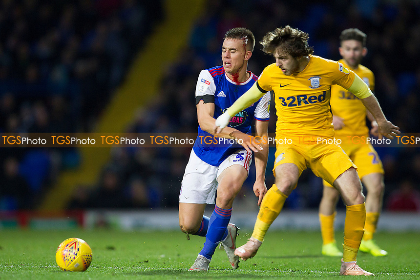 Jonas Knudsen of Ipswich Town wins the challenge with Ben Pearson of Preston North End during Ipswich Town vs Preston North End, Sky Bet EFL Championship Football at Portman Road on 3rd November 2018