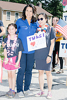 Democratic presidential candidate and Hawaii representative (D-HI 2nd) Tulsi Gabbard greets supporters while marching in the 4th of July Parade in Amherst, New Hampshire, on Thu., July 4, 2019.