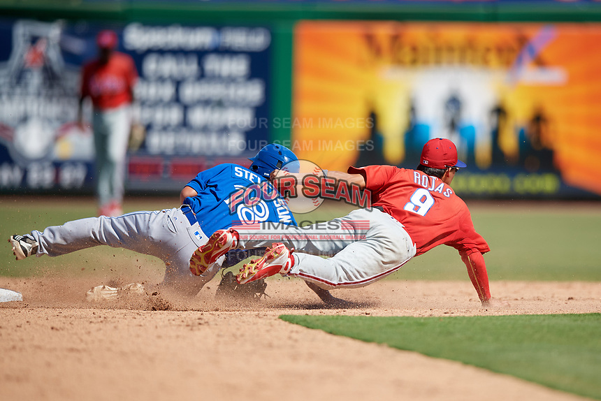 Philadelphia Phillies second baseman Luis Rojas (9) reaches out to try to receive a throw as Cal Stevenson (18) slides into second base during a Florida Instructional League game against the Toronto Blue Jays on September 24, 2018 at Spectrum Field in Clearwater, Florida.  (Mike Janes/Four Seam Images)
