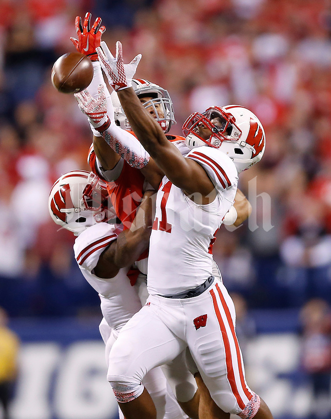 Ohio State Buckeyes running back Jalin Marshall (17) fails to catch a pass under heavy pressure from Wisconsin Badgers cornerback Peniel Jean (21) and Wisconsin Badgers cornerback Darius Hillary (5) in the first quarter of the Big Ten Championship game between the Ohio State Buckeyes and the Wisconsin Badgers at Lucas Oil Stadium in Indianapolis, Saturday night, December 6, 2014. As of half time the Ohio State Buckeyes led the Wisconsin Badgers 38 - 0. (The Columbus Dispatch / Eamon Queeney)