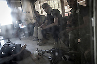 Rebel fighters belonging to the Liwa Al Tawhid takes a rest at the rebel post in Zahoor before move to the fighting at the Saif Al Dawla battlefield in southwest of Aleppo City. During last days the first line of fighting have moved into Saif Al Dawla residential neighborhood for the control of the area.