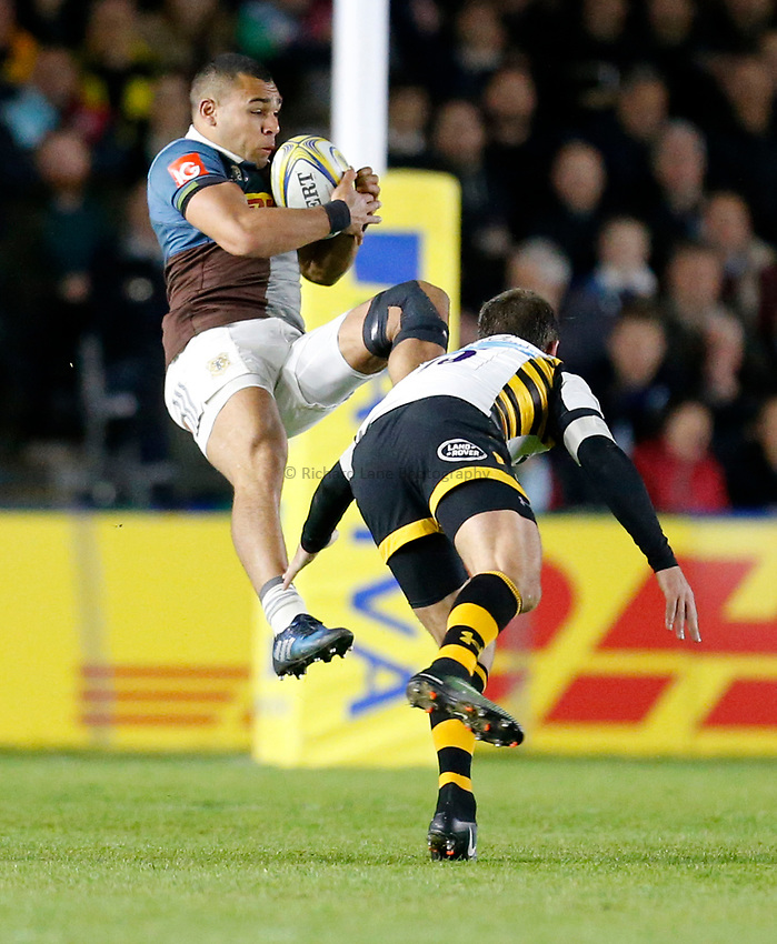 Photo: Richard Lane/Richard Lane Photography. Aviva Premiership. Harlequins v Wasps. 28/04/2017. Quins' Joe Marchant is tackled in the air by Wasps' Willie Le Roux.