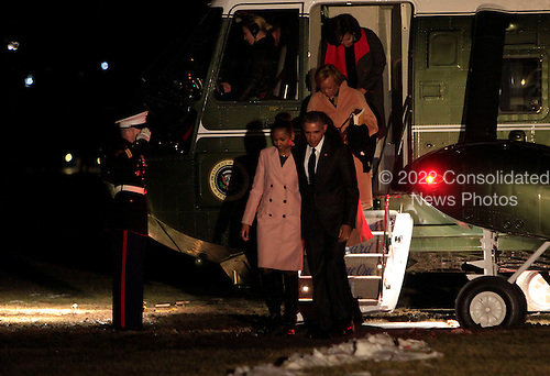 United States President Barack Obama with daughter Sasha, Marian Robinson and First Lady Michelle Obama walk from Marine One to enter the White House following a trip to Selma, Alabama on March 7, 2015.<br /> Credit: Dennis Brack / Pool via CNP