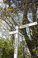 Old distance quaint signpost to Helford half a mile,  Helston and Treath quarter of a mile in Cornwall, England, UK