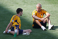 LA Galaxy players FWD David Beckham (R-23)   and MID Kyle Martino (L-18) chat while stretching at Beckham's first practice with the LA Galaxy at the Home Depot Center in Carson, California, Monday, July 16, 2007.