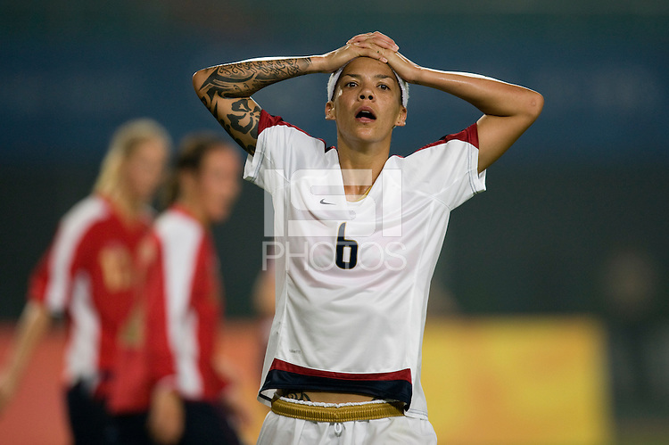 USWNT forward (6) Natasha Kai reacts to a missed shot during first round play for the 2008 Beijing Olympics in Qinhuangdao, China. .  The US lost to Norway, 2-0, at Qinhuangdao Stadium.