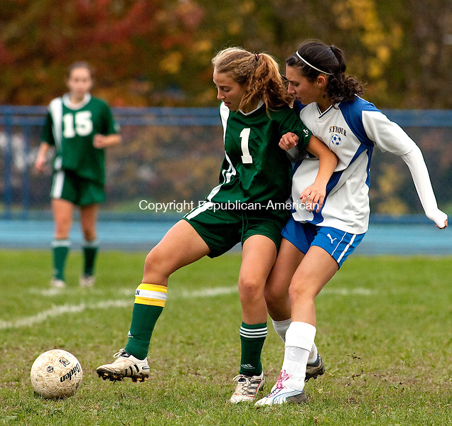 SEYMOUR, CT, 18 OCTOBER 2010-101810JS06-Holy Cross' Andrea Broderick (1) tries to hold off Seymour's Reba Putorti (17) during their game Monday at Seymour High School. <br />  Jim Shannon Republican-American