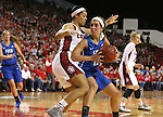 VERMILLION, SD, APRIL 2:  Stephanie Haas #12 from Florida Gulf Coast looks to make a move against Jasmine Trimboli #5 from the University of South Dakota during the WNIT Championship game Saturday afternoon at the Dakota Dome in Vermillion, S.D. (Photo by Dave Eggen/Inertia)