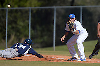 South Dakota State JackRabbits first baseman Aaron Machbitz (33) waits for a throw as Evan Ryan (34) dives back during a game against the Georgetown Hoyas at South County Regional Park on March 9, 2014 in Port Charlotte, Florida.  Georgetown defeated South Dakota 7-4.  (Mike Janes/Four Seam Images)