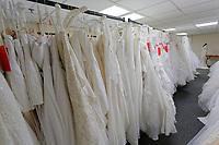 "COPY BY TOM BEDFORD<br /> Pictured: at the John Pye Auctions warehouse in Pyle, south Wales, UK.<br /> Re: A bride cried tears of joy after her missing wedding dress was found among a pile of 20,000 gowns in a warehouse.<br /> Meg Stamp, 27, paid £1,300 for the beautiful ivory lace dress but it  was seized by liquidators after a bridal company went bust.<br /> It was boxed up along with 20,000 others and due to be sold for a knock-down price at auction.<br /> But determined Meg banged on the auctioneer door saying: ""I want my dress back"".<br /> Staff at John Pye auctioneers in Port Talbot spent three hours sifting through boxes until they finally found Meg's dream dress."
