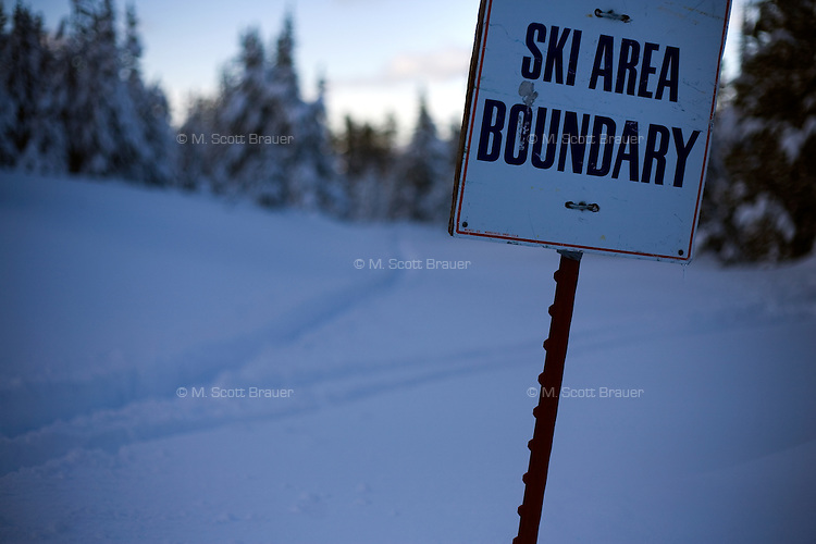 A sign indicates the ski area boundary at Showdown Ski Area on King's Hill in the Little Belt Mountains near Neihart, Montana, USA.