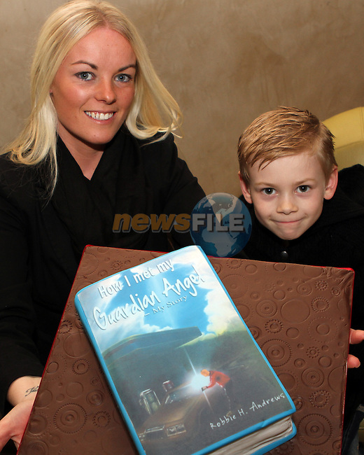 "Cian and Vicki Shannon with the Suprise cake made by ""All Occasion Catering"" at the Launch of Robbie Andrew's Book in the D Hotel...(Photo credit should read Jenny Matthews/NEWSFILE)..."