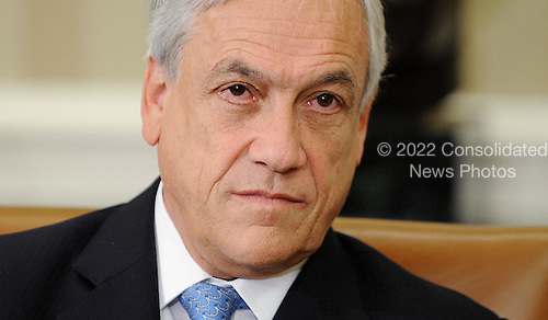 President Sebasti&aacute;n Pi&ntilde;era of Chile makes a statement to the press after meeting with United States President Barack Obama (not pictured) in the Oval Office of the White House June 4 , 2013 in Washington, DC. <br /> Credit: Olivier Douliery / Pool via CNP