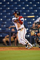 Mississippi Braves second baseman Alay Lago (19) follows through on a swing in front of catcher Michael Barash (16) during a game against the Mobile BayBears on May 7, 2018 at Trustmark park in Pearl, Mississippi.  Mobile defeated Mississippi 5-0.  (Mike Janes/Four Seam Images)