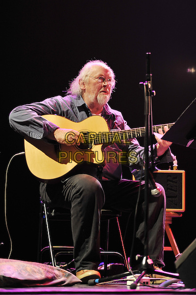 John Renbourn of Pentangle.Vintage 2011 at Royal Festival Hall, London, England, UK..July 31st, 2011.stage concert live gig performance music full length grey gray shirt black trousers sitting guitar.CAP/MAR.© Martin Harris/Capital Pictures.
