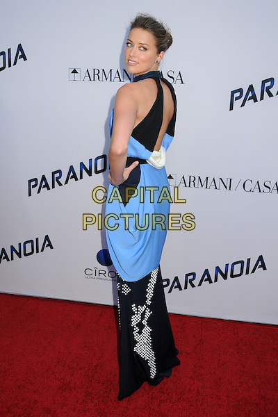 Amber Heard<br /> &quot;Paranoia&quot; Los Angeles Premiere held at the Directors Guild of America, West Hollywood, California, USA, 8th August 2013.<br /> full length long maxi black dress hand on hip back over shoulder rear behind blue dress cut side white print <br /> CAP/ADM/BP<br /> &copy;Byron Purvis/AdMedia/Capital Pictures