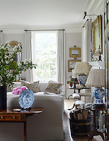 The muted palette of the drawing room is complemented with furnishings in a classically English style