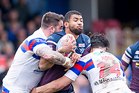 Picture by Allan McKenzie/SWpix.com - 08/04/2018 - Rugby League - Betfred Super League - Wakefield Trinity v Leeds Rhinos - The Mobile Rocket Stadium, Wakefield, England - Leeds's Kallum Watkins is tackled by Wakefield's Craig Huby & Justin Horo.