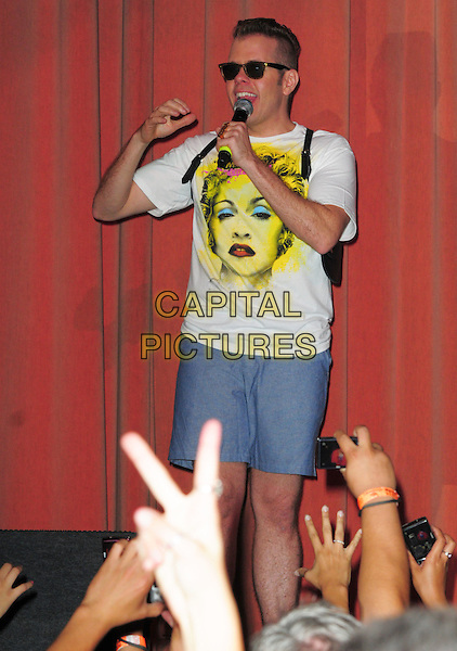 PEREZ HILTON .at Perez Hilton's 'One Night In Los Angeles' held at the Wiltern Theatre, USA, Los Angeles, CA, USA, .11th September 2010..half length on stage sunglasses microphone speaking white madonna t-shirt music shorts blue 3/4 .CAP/ADM/DT.©Daniel Tanner/AdMedia/Capital Pictures.