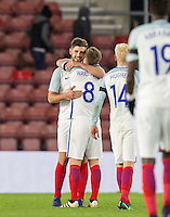 Winning goalscorer Jack Stephens (left) (Southampton) of England embraces James Ward-Prowse (Southampton) of England on the final whistle during the Under 21 International Friendly match between England and Italy at St Mary's Stadium, Southampton, England on 10 November 2016. Photo by Andy Rowland.