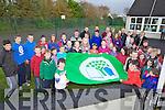 GOING GREEN: Ballyfinnane national school pupils, parents and staff raising their Green Flag with Kerry star Marc Ó Sé on Monday evening.