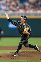 Vanderbilt Commodores pitcher Carson Fulmer (15) delivers a pitch to the plate during the NCAA College baseball World Series against the Cal State Fullerton Titans on June 14, 2015 at TD Ameritrade Park in Omaha, Nebraska. The Titans were leading 3-0 in the bottom of the sixth inning when the game was suspended by rain. (Andrew Woolley/Four Seam Images)