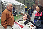Arnie Abrams seen with Brooke Ellison and her mother, ? on the campus of Harvard University, in Boston, MA on May 14, 2000. Photo by Jim Peppler.