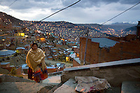 26 year old wrestler Yolanda La Amorosa (fighting name), Veraluz Cortez (real name) walks up steps in her neighbourhood overlooking La Paz. Veraluz is a Cholita, a wrestler of native Aymara descent. When Cholitas fight they wear traditional costume. Veraluz fights with the lucha libre (free wrestling) group Los Diosas del Ring. ..