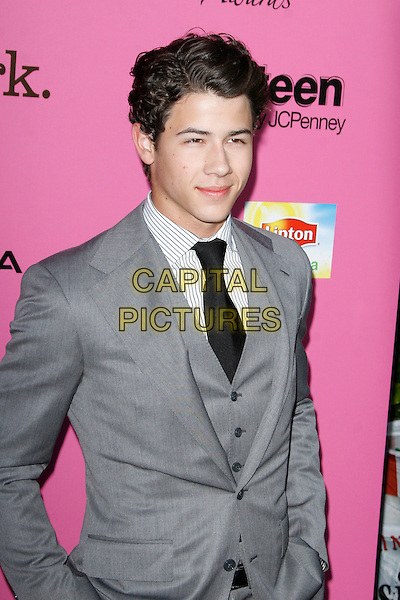 NICK JONAS of JONAS BROTHERS.arriving at the 12th Annual Young Hollywood Awards held at  Wilshire Ebell Theatre in Los Angeles, California, USA, May 13th, 2010..half length black tie grey gray suit waistcoat .CAP/ROT/MC.©Max Cash/ Roth Stock/Capital Pictures