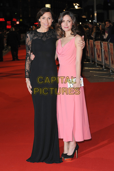 Minnie Driver and Rose Byrne.attends the UK Premiere of 'I Give It A Year', Vue West End cinema, London, England, UK, 24th January 2013..full length dress sleeveless clutch bag white draped cowl neck  black shoes  pink lace long maxi sleeve arm around gold platform.CAP/BEL.©Tom Belcher/Capital Pictures.