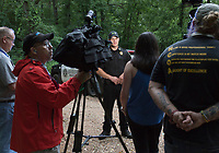 NWA Democrat-Gazette/CHARLIE KAIJO Capt. Chris Kelley with the Gravette police department speaks during a press conference, Friday, July 5, 2019 at a media staging area on the intersection of Crossover Rd and Gorden Hollow Rd in Gravette. <br /> <br /> Police responded to a shooting situation that left four people dead in an apparent murder suicide on a nearby property. All four people are related or lived at the residence. One body was found on the driveway. Authorities do not believe there is a danger to the public.