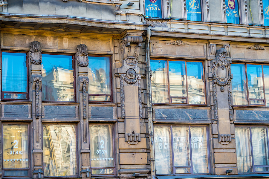 ST. PETERSBURG - CIRCA MARCH 2013: Architectural detail of facade in Nevsky Prospect Ave. in St. Petersburg, circa March 2013. This is a tourist attraction with 221 museums, 2000 libraries, and 80  plus theaters within the city.