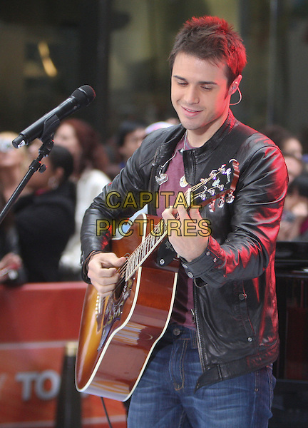 KRIS ALLEN.The 'TODAY Show' in Rockefeller Plaza, New York, NY, USA..May 28th, 2009 .American Idol season 8 half length black leather jacket chris stage concert live gig performance music guitar .CAP/LNC/LJ.©Louis Jeunet/LNC/Capital Pictures.