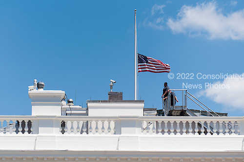 White House personnel leave the roof after lowering the flag to half staff following United States President Barack Obama's statement in the Brady Press Briefing Room in Washington, District of Columbia, U.S., on Sunday, June 12, 2016, about the deadly shooting the night before in a gay nightclub in Orlando FL. Approximately 50 people were killed and at least 53 more were injured in what appears to be the deadliest mass shooting in U.S. history. <br /> Credit: Pete Marovich / Pool via CNP
