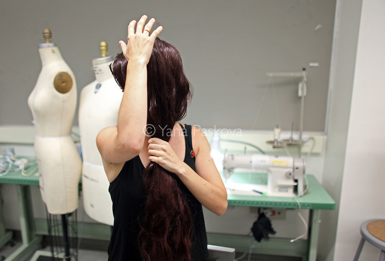 Lucia Cuba shows a front wig from her accessory collection at Parsons The New School for Design in Manhattan, New York on Monday, July 23, 2012.