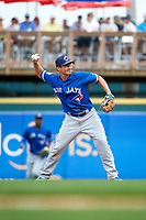 Toronto Blue Jays second baseman Darwin Barney (18) throws to first during a Spring Training game against the Pittsburgh Pirates on March 3, 2016 at McKechnie Field in Bradenton, Florida.  Toronto defeated Pittsburgh 10-8.  (Mike Janes/Four Seam Images)