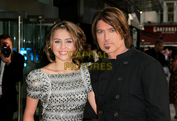 "MILEY CYRUS & BILLY RAY CYRUS .UK Premiere of ""Hannah Montana: The Movie"" at the Odeon Leicester Square, London, England. .April 23rd 2009 .half length silver grey gray beaded beads embellished jewel encrusted dress shoulder pads structured shoulders sculpted soul patch facial hair  black jacket father dad daughter family .CAP/AH.©Adam Houghton/Capital Pictures."