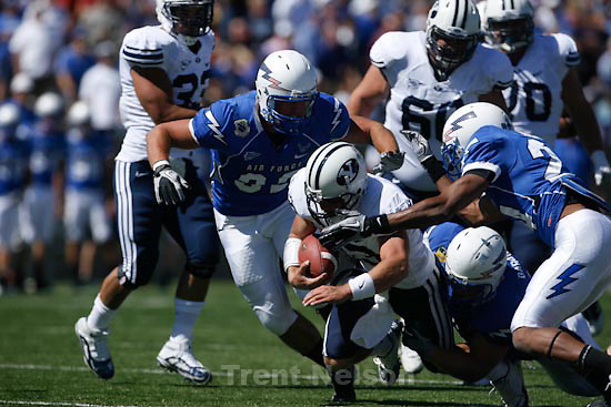 Trent Nelson  |  The Salt Lake Tribune.BYU quarterback Riley Nelson is brought down in the first quarter as BYU faces Air Force at the Air Force Academy, college football Saturday, September 11, 2010.