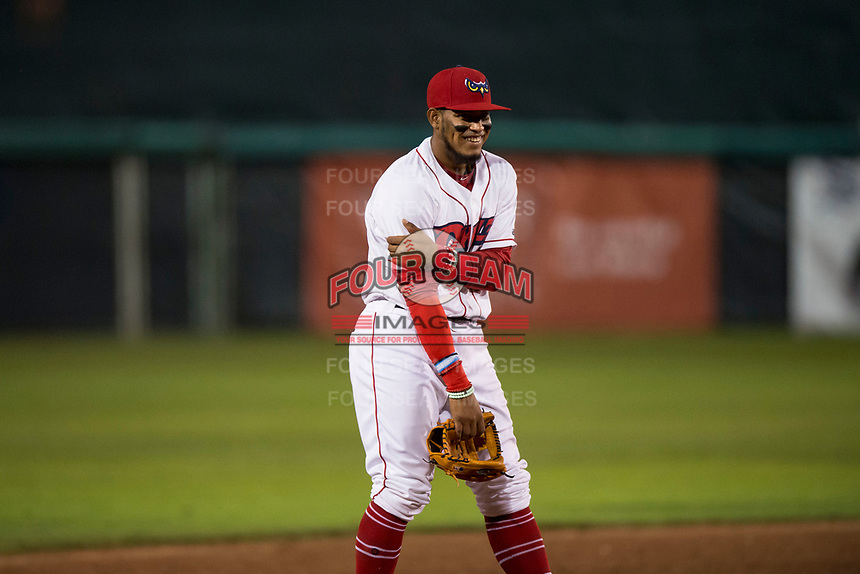 Orem Owlz third baseman Kevin Maitan (9) goofs around during a Pioneer League game against the Ogden Raptors at Home of the OWLZ on August 24, 2018 in Orem, Utah. The Ogden Raptors defeated the Orem Owlz by a score of 13-5. (Zachary Lucy/Four Seam Images)