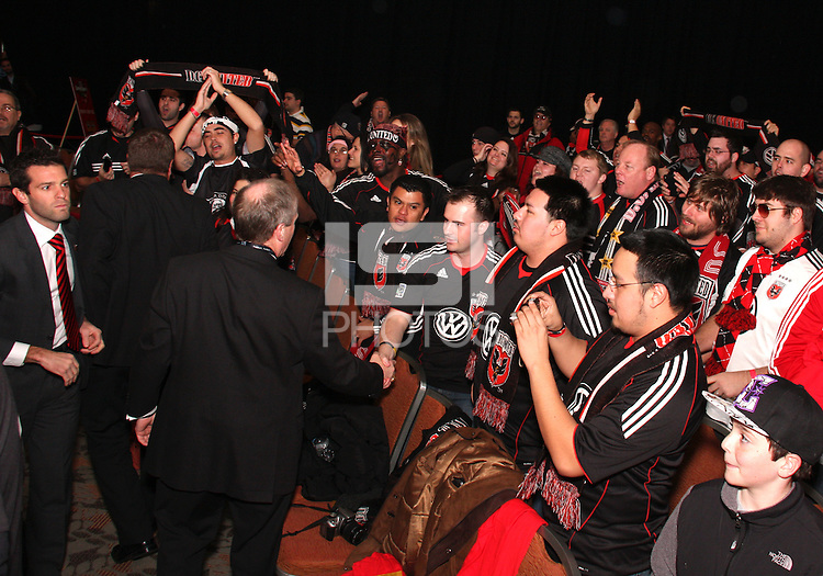 Kevin Payne greets D.C. United fans at the 2011 MLS Superdraft, in Baltimore, Maryland on January 13, 2010.