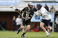 CHAPEL HILL, NC - MARCH 10: Kevin Groeninger #9 of Bryant University is defended by Parker Alexander #23 of the University of North Carolina during a game between Bryant and North Carolina at Dorrance Field on March 10, 2020 in Chapel Hill, North Carolina.