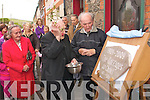 5130-5131.---------.Plaque Unveiling.----------------.Padraig Lynch(Rt)who is the oldest resident of the Cottages of the wood Dingle watches Canon Jackie McKenna bless a stone plaque dated 1909-2009 before a special mass for past and present resident's last Saturday evening in Dingle.