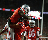 Ohio State Buckeyes running back Dontre Wilson (2) reacts with Ohio State Buckeyes running back Jalin Marshall (17) after scoing a touchdown during the third quarter of Saturday's NCAA Division I football game at Ohio Stadium in Columbus on September 27, 2014. (Columbus Dispatch photo by Jonathan Quilter)