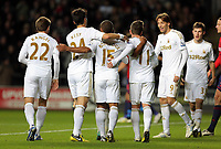 Sunday, 28 November 2012<br /> Pictured: Wayne Routledge of Swansea (C) celebrating his second goal with fellow players<br /> Re: Barclays Premier League, Swansea City FC v West Bromwich Albion at the Liberty Stadium, south Wales.
