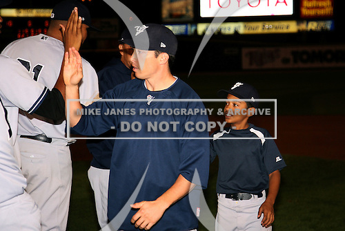 September 4, 2009:  Doug Bernier of the Scranton Wilkes-Barre Yankees high fives teammates after the team won the International League North Division at Frontier Field in Rochester, NY.  Scranton is the International League Triple-A affiliate of the New York Yankees.  Photo by:  Mike Janes/Four Seam Images