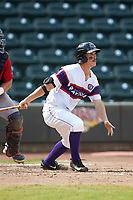 J.J. Muno (12) of the Winston-Salem Rayados follows through on his swing against the Potomac Nationals at BB&T Ballpark on August 12, 2018 in Winston-Salem, North Carolina. The Rayados defeated the Nationals 6-3. (Brian Westerholt/Four Seam Images)