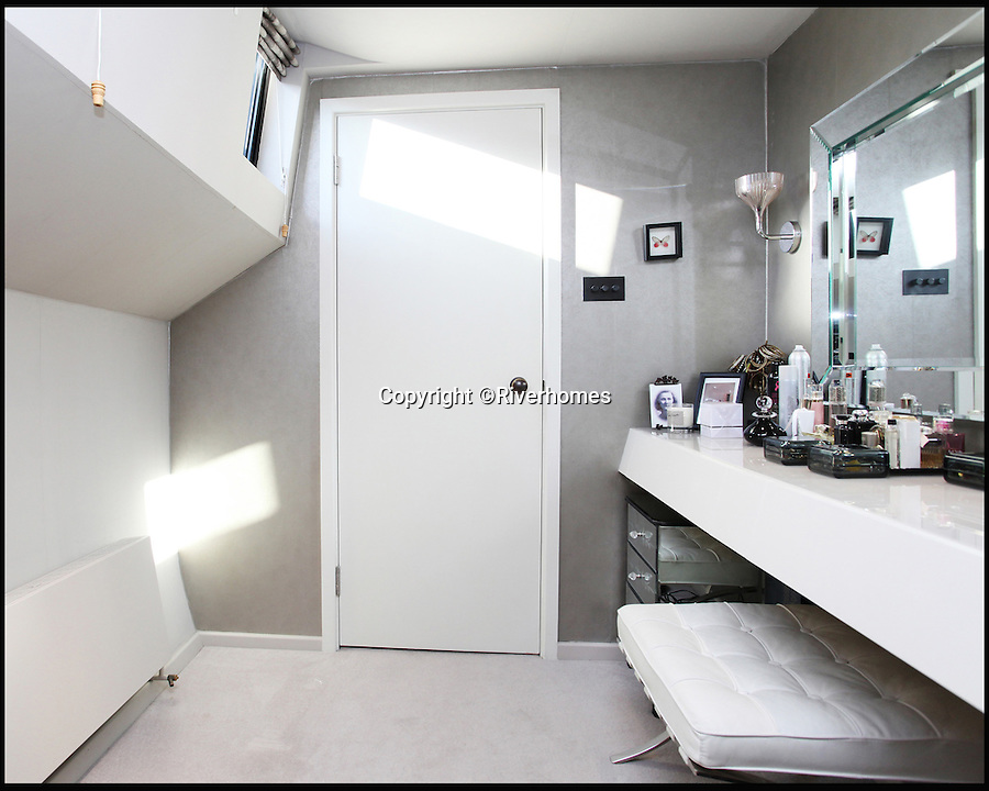 BNPS.co.uk (01202 558833)<br /> Pic: Riverhomes/BNPS<br /> <br /> Dressing room.<br /> <br /> Heart of Lightness - Tardis like houseboat on the Thames.<br /> <br /> A houseboat that looks more like a luxurious penthouse suite inside has gone on the market for a whopping £1.5 million - because it's in one of London's most exclusive locations.<br /> <br /> The 100ft vessel was once a former Dutch barge taking supplies up and down the Thames until it was retired from service in the 1960s and left to rot.<br /> <br /> But a decade later it was salvaged and turned into a houseboat before undergoing a complete refurbishment four years ago and moved to a premier mooring alongside one the swankiest addresses in the city.<br /> <br /> The plush houseboat, berthed at the entrance to Cheyne Walk, now boasts a lavish living room, stylish 50ft-long kitchen, a spiral staircase, two opulent bedrooms, three bathrooms and even a sun terrace.<br /> <br /> And despite its eye-watering £1.5m asking price, experts at Riverhomes estate agents say the houseboat is actually a bargain and that anyone wanting to live in such luxury in the heart of Chelsea would have to shell out many millions more.