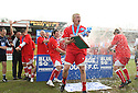 Mark Roberts of Stevenage Borough celebrates with the Blue Square Premier championship trophy after the Blue Square Premier match between Stevenage Borough and York City at the Lamex Stadium, Broadhall Way, Stevenage on Saturday 24th April, 2010..© Kevin Coleman 2010 ..