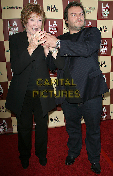 "Shirley MacLaine and Jack Black.2011 Los Angeles Film Festival Opening Night Premiere of ""Bernie"" held at Regal Cinemas LA Live, Los Angeles, California, USA..June 16th, 2011.full length suit jacket holding hands blue pinstripe stubble facial hair trousers .CAP/ADM.©AdMedia/Capital Pictures."