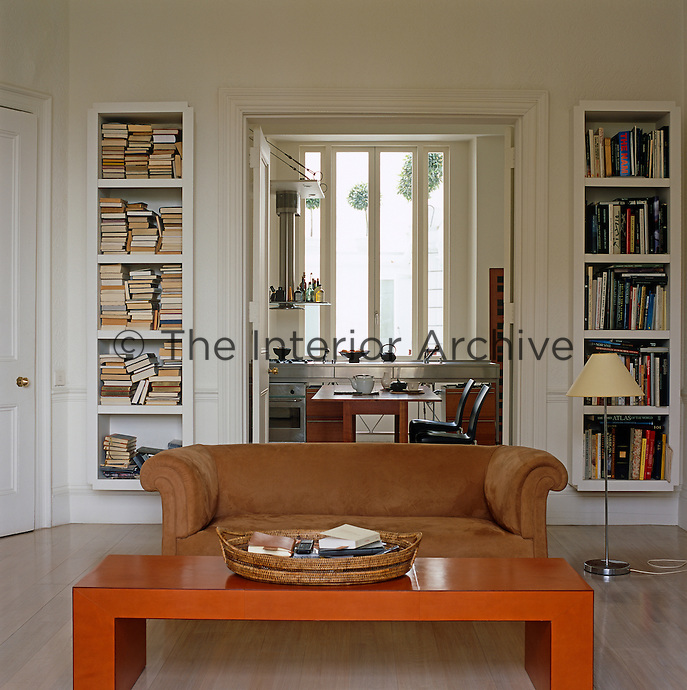 View From The Living Room Through Double Doors Flanked By A Pair Of Bespoke Bookshelves Into